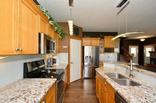 Photo 8: 12 BOW RIDGE Drive: Cochrane House for sale : MLS®# C4129947