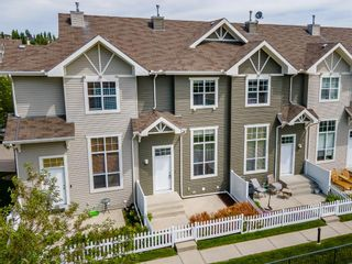 Photo 1: 119 Toscana Gardens NW in Calgary: Tuscany Row/Townhouse for sale : MLS®# A1121039