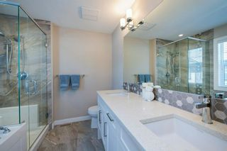 Photo 29: 110 Wentworth Row SW in Calgary: West Springs Row/Townhouse for sale : MLS®# A1100774