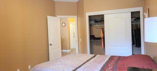 Photo 20: 106 248 Sunterra Ridge Place: Cochrane Apartment for sale : MLS®# A1097518