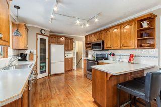 Photo 8: 28 Kelvin Place SW in Calgary: Kingsland Detached for sale : MLS®# A1079223