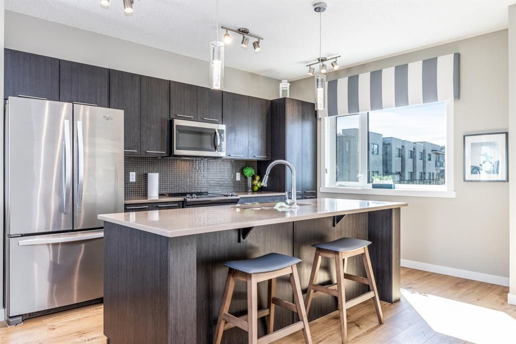 Main Photo: 1001 218 Sherwood Square NW in Calgary: Sherwood Row/Townhouse for sale : MLS®# A1147454