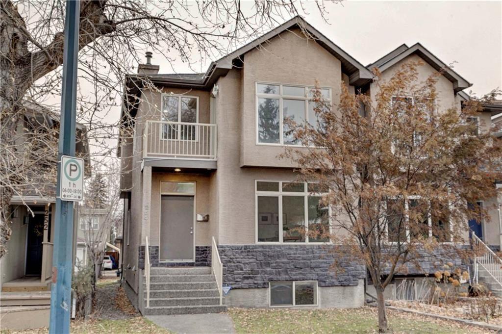 Main Photo: 254 21 Avenue NE in Calgary: Tuxedo Park Semi Detached for sale : MLS®# C4275757