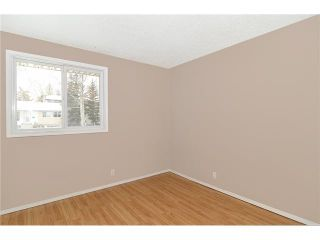 Photo 10: 409 RANCHVIEW Court NW in CALGARY: Ranchlands Residential Attached for sale (Calgary)  : MLS®# C3554095
