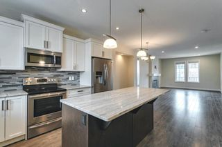 Photo 17: 134 Cooperswood Place SW: Airdrie Semi Detached for sale : MLS®# A1129880
