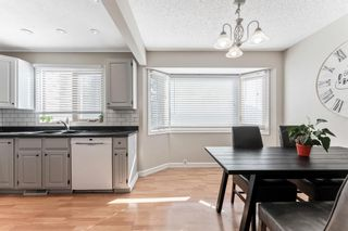 Photo 15: 108 Glamis Terrace SW in Calgary: Glamorgan Row/Townhouse for sale : MLS®# A1070053