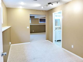 Photo 19: 107 Mt Allan Circle SE in Calgary: McKenzie Lake Detached for sale : MLS®# A1068557