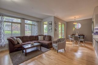 "Photo 1: 10180 153 Street in Surrey: Guildford Condo for sale in ""Charlton Park"" (North Surrey)  : MLS®# R2388907"