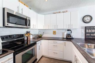 Photo 2: 10418 28A Avenue in Edmonton: Zone 16 Townhouse for sale : MLS®# E4239227