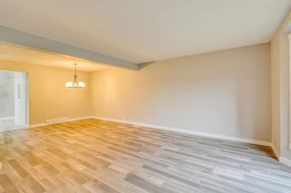 Photo 13: 215 Strathearn Crescent SW in Calgary: Strathcona Park Detached for sale : MLS®# A1146284