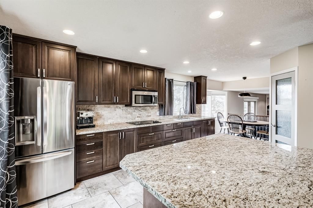 Main Photo: 335 Woodpark Place SW in Calgary: Woodlands Detached for sale : MLS®# A1110869