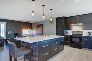 Photo 4: 204 MAPLE COURT Crescent SE in Calgary: Maple Ridge Detached for sale : MLS®# A1152517