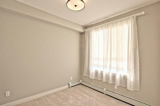 Photo 23: 308 10 WALGROVE Walk SE in Calgary: Walden Apartment for sale : MLS®# A1032904