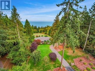 Main Photo: 5604 Hiquebran Rd in Nanaimo: House for sale : MLS®# 887951
