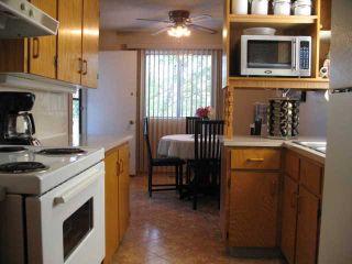 Photo 3: 7637 25 Street SE in CALGARY: Ogden_Lynnwd_Millcan Townhouse for sale (Calgary)  : MLS®# C3585665