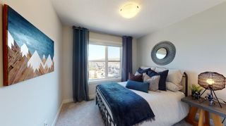 Photo 19: 509 Crestridge Common SW in Calgary: Crestmont Row/Townhouse for sale : MLS®# A1109996