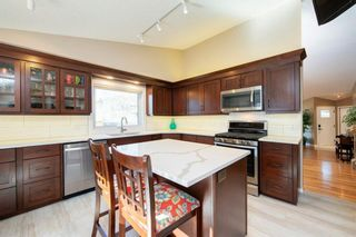 Photo 11: 208 Strathcona Mews SW in Calgary: Strathcona Park Detached for sale : MLS®# A1094826