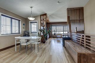 Photo 2: 230 EVERSYDE Boulevard SW in Calgary: Evergreen Apartment for sale : MLS®# A1071129