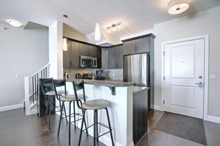 Photo 8: 2407 15 SUNSET Square: Cochrane Apartment for sale : MLS®# A1072593