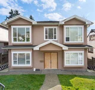 Photo 1: 1776 E 64TH Avenue in Vancouver: Fraserview VE House for sale (Vancouver East)  : MLS®# R2557677