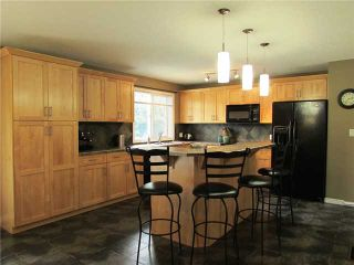 """Photo 2: 10307 109TH Avenue in Fort St. John: Fort St. John - City NW House for sale in """"FINCH"""" (Fort St. John (Zone 60))  : MLS®# N230305"""
