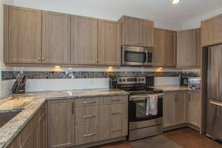 Photo 11: 124 Kingsmere Cove SE: Airdrie Detached for sale : MLS®# A1115152