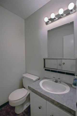 Photo 20: 104 210 86 Avenue SE in Calgary: Acadia Row/Townhouse for sale : MLS®# A1148130