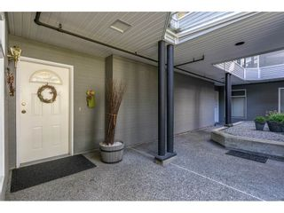 """Photo 2: 102 2733 ATLIN Place in Coquitlam: Coquitlam East Condo for sale in """"ATLIN COURT"""" : MLS®# R2475795"""