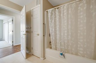 Photo 16: 301 305 1 Avenue NW: Airdrie Apartment for sale : MLS®# A1134588
