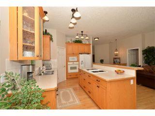 Photo 10: 134 GLENEAGLES View: Cochrane House for sale : MLS®# C4018773