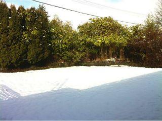 Photo 11: 1151 TATLOW AV in North Vancouver: Norgate House for sale : MLS®# V1049115