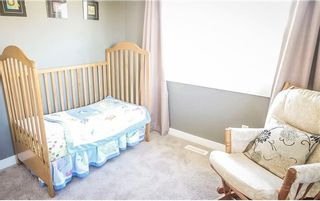 Photo 16: 95 West Coach Manor SW in Calgary: West Springs Row/Townhouse for sale : MLS®# A1114599