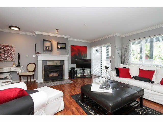 """""""Super spacious living space with cozy gas fireplace and windows galore open to a beautiful circular deck that is a true extension of the home. Features elegant laminate flooring"""
