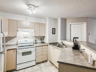Photo 5: 8425 304 Mackenzie Way SW: Airdrie Apartment for sale : MLS®# A1085933