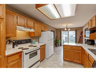 """Photo 11: 103 5641 201 Street in Langley: Langley City Townhouse for sale in """"THE HUNTINGTON"""" : MLS®# R2537246"""