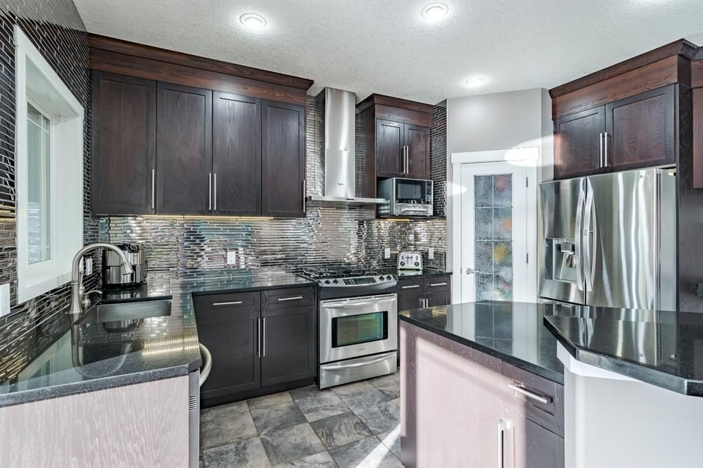 Main Photo: 87 Panatella Drive NW in Calgary: Panorama Hills Detached for sale : MLS®# A1107129