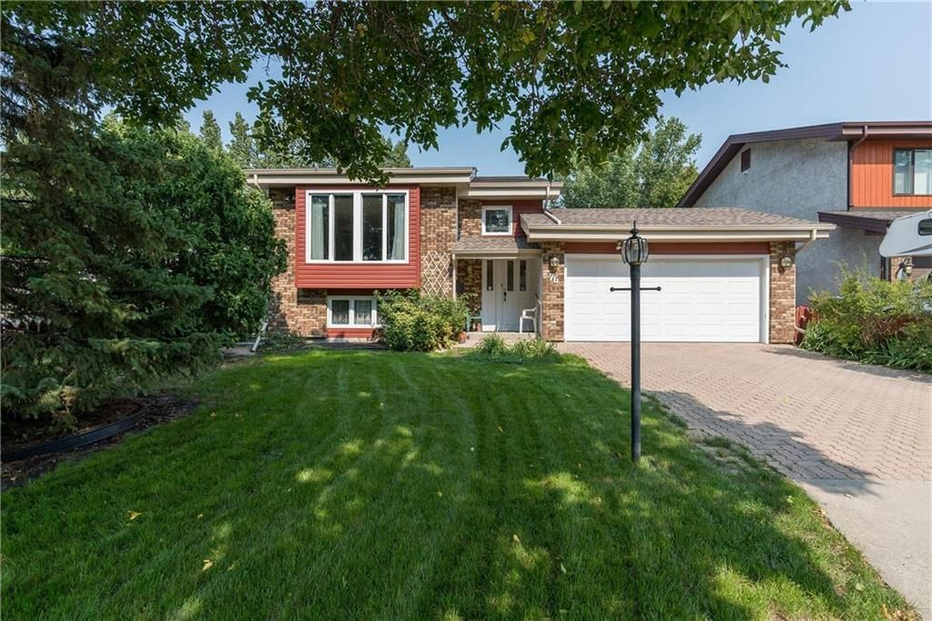 Beautiful curb appeal + homes features a double garage!
