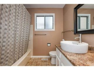 Photo 19: 503 RANCHRIDGE Court NW in Calgary: Ranchlands House for sale : MLS®# C4118889