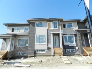 Photo 2: 1052 Lanark Boulevard SE: Airdrie Row/Townhouse for sale : MLS®# A1052705