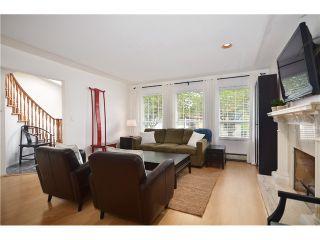 """Photo 4: 878 E 23RD AV in Vancouver: Fraser VE House for sale in """"CEDAR COTTAGE"""" (Vancouver East)  : MLS®# V1022949"""