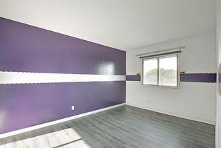 Photo 11: 1002 919 38 Street NE in Calgary: Marlborough Row/Townhouse for sale : MLS®# A1140399