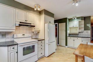 Photo 12: 132 LAKE ADAMS Green SE in Calgary: Lake Bonavista House for sale : MLS®# C4142300