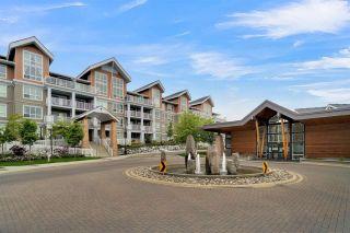"Photo 1: B102 6490 194 Street in Surrey: Clayton Condo for sale in ""Waterstone"" (Cloverdale)  : MLS®# R2577812"