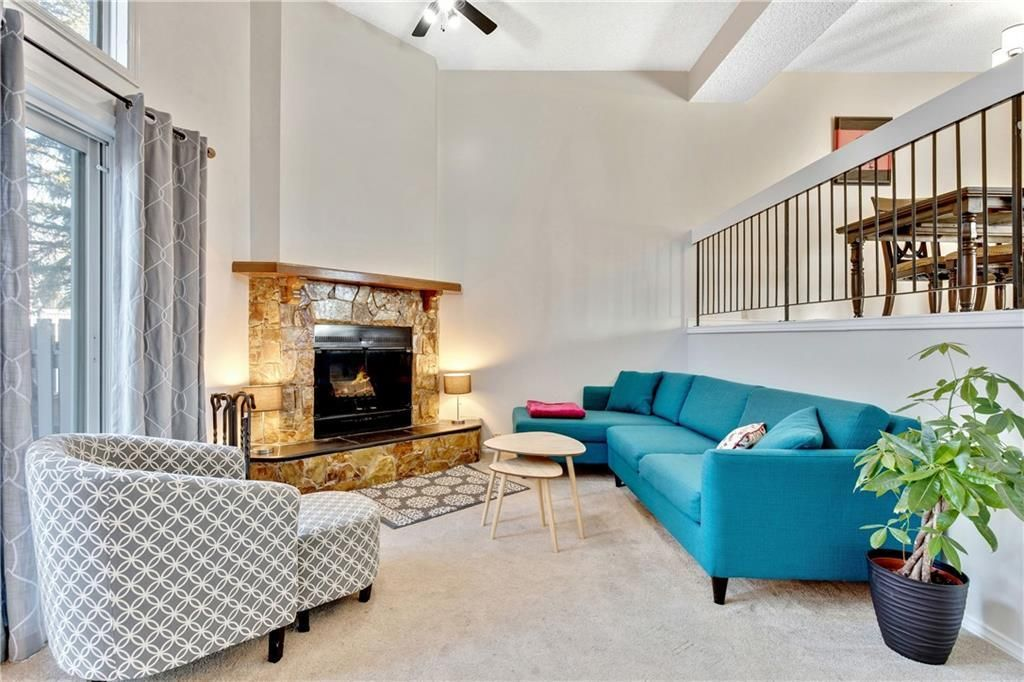 Vaulted ceilings in the living room bring in lots of natural light and the cozy wood-burning fireplace is perfect for cold weather