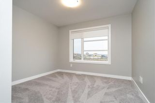 Photo 20: 229 Ken Oblik Drive in Winnipeg: Prairie Pointe Residential for sale (1R)  : MLS®# 202124757