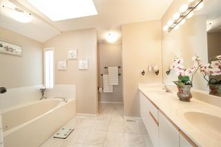 Photo 13: 211 Coachway Road SW in Calgary: Coach Hill Detached for sale : MLS®# A1088141