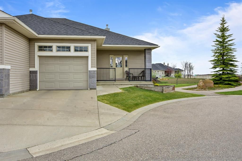 Main Photo: 45 Stromsay Gate: Carstairs Row/Townhouse for sale : MLS®# A1110468