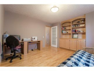 Photo 17: 69 STRATHLEA Place SW in Calgary: Strathcona Park House for sale : MLS®# C4101174