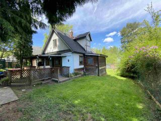 Photo 1: 2229 CLARKE Street in Port Moody: Port Moody Centre House for sale : MLS®# R2556700