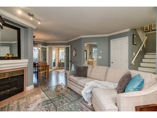 """Photo 1: 112 13900 HYLAND Road in Surrey: East Newton Townhouse for sale in """"Hyland Grove"""" : MLS®# R2336743"""